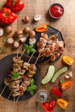 Grilled meat (kebab) with vegetables Stock Images