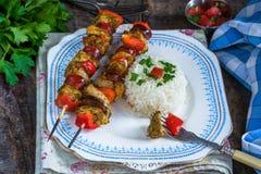 Grilled meat kebabs on skewers Stock Image