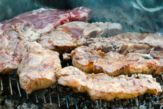 Grilled meat. Making Pork meat on grill for dinner Royalty Free Stock Images