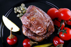 Grilled meat medallion with cherry Royalty Free Stock Photos