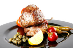 Grilled meat medallion with cherry Royalty Free Stock Image