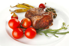 Grilled meat medallion with cherry Royalty Free Stock Photography