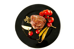 Grilled meat medallion served on Royalty Free Stock Photos