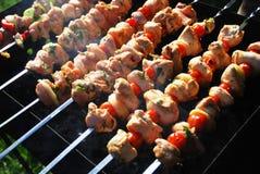 Grilled meat on metal skewers Stock Photo