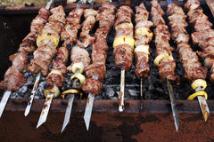 Grilled meat on metal skewers cooking on a coal Stock Image