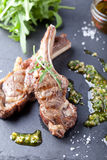 Grilled meat, mutton, lamb rack with fresh salad. Stock Image