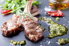 Grilled meat, mutton, lamb rack with fresh salad. Stock Photo