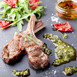 Grilled meat, mutton, lamb rack with fresh salad. Royalty Free Stock Photos