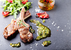 Grilled meat, mutton, lamb rack with fresh salad. Stock Photos