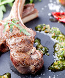 Grilled meat, mutton, lamb rack with fresh salad. Stock Photography