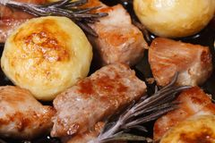 Grilled meat and new potatoes horizontal. Macro Royalty Free Stock Photo