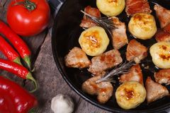 Grilled meat and new potatoes in a pan Royalty Free Stock Photos