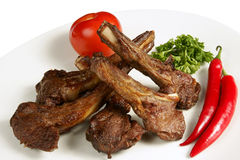 Grilled Meat On The Bone With Fresh Vegetables On Royalty Free Stock Photos