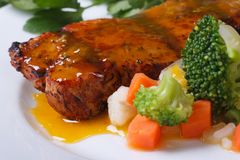 Grilled meat with orange sauce and vegetables Stock Photos
