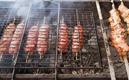 Grilled meat over the coals on a barbecue, kebab Royalty Free Stock Photos