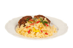 Grilled meat and pasta. Pasta and chopped steak on a white plate Stock Images