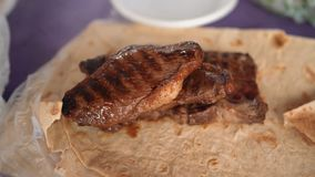 Grilled meat with pita bread stock photo
