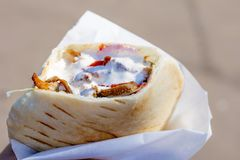 Grilled meat in pita bread with vegetable salad royalty free stock image
