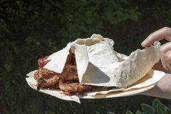 Grilled meat on pita. Royalty Free Stock Images