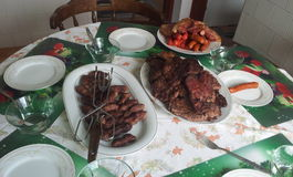 Grilled meat. Plate on the table royalty free stock photo
