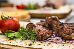 Grilled meat on plate with vegetables. Restaurant serving Royalty Free Stock Images