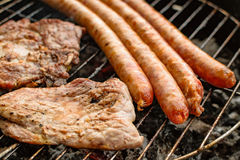 Grilled meat, pork, beef and sausage on barbecue, grill Stock Image