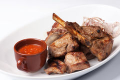 Grilled meat with red sauce Stock Photo