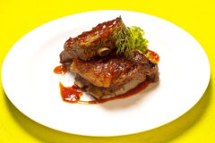 Grilled meat ribs. On white plate royalty free stock image