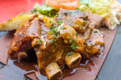 Grilled meat ribs on the plate with hot sauce Stock Image