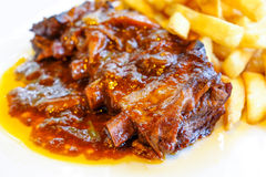 Grilled meat ribs on the plate Royalty Free Stock Photography