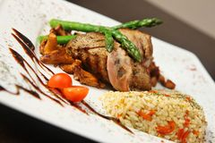 Grilled meat with rice Stock Images