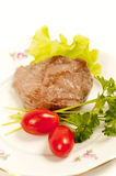 Grilled meat. Roast beef garnished with greens and tomatoes Stock Image