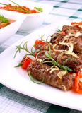 Grilled meat rolls with giant white beans and sauce Royalty Free Stock Images