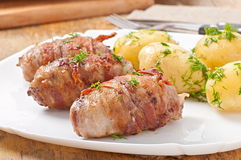Grilled meat rolls wrapped in strips of bacon Royalty Free Stock Images