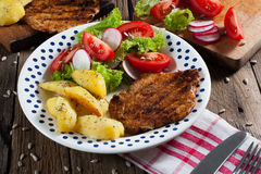 Grilled meat with salad. Grilled meat with salad and roasted potatoes Stock Photo