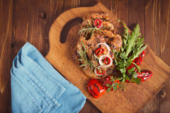 Grilled meat with salad and vegetables. Food. Sliced pieces of raw Meat for barbecue with fresh Vegetables and Mushrooms on wooden surface. Meat Raw Steak. Beef Royalty Free Stock Images