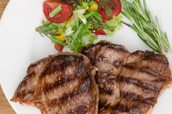 Grilled meat with salad at white plate Stock Photography