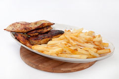 Grilled meat served with fries Royalty Free Stock Image