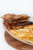 Grilled meat served with fries Stock Image