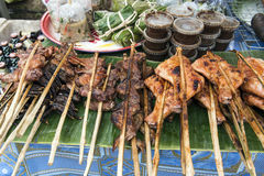 Grilled meat on a skewer. In the local market in Lao Stock Photos