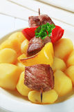Grilled meat skewer and potatoes Royalty Free Stock Photos