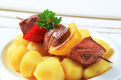 Grilled meat skewer and potatoes Stock Photography