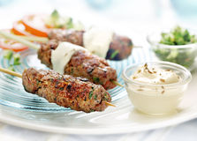 Grilled meat skewer Stock Images