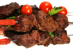 Grilled meat on skewer with tomatoes Royalty Free Stock Images