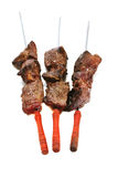 Grilled meat on skewer with tomatoes Stock Photography