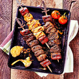 Grilled Meat Skewers with Fresh Ingredients stock images
