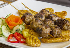 Grilled meat skewers Stock Photos