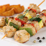 Grilled meat skewers with potato wedges Royalty Free Stock Images