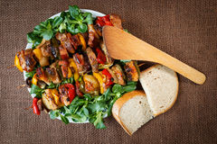 Grilled meat skewers with vegetables and bread Stock Photos