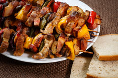 Grilled meat skewers with vegetables and bread Royalty Free Stock Image